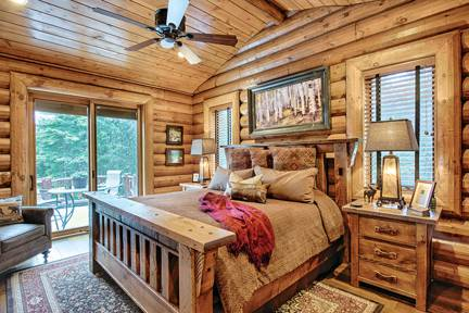 bedroom-windows-patio-door-wood-flooring-interior-dowell-golden-eagle-log-homes-2-2